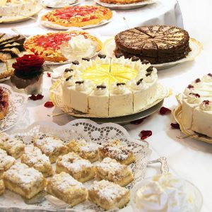 Cake buffet with various cakes decorated with flowers